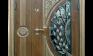 Дверь двустворчатая со стеклом и ковкой